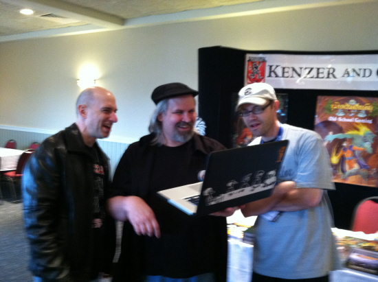 Dave Kenzer, Jolly Blackburn and Steve Johansson share a laugh at the KenzerCo booth.