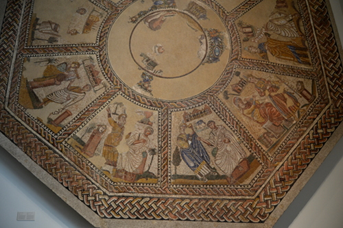 Mosaic of the Muses, from a 4th century AD villa in Arellano (modern Navarre). Each muse is shown with a master of the art, so Urania is shown with Aratus, Calliope with Homer, Erato with an unidentified master, Melpomene with an unidentified master, Euterpe with Hyagnis, and Clio with Caducus.
