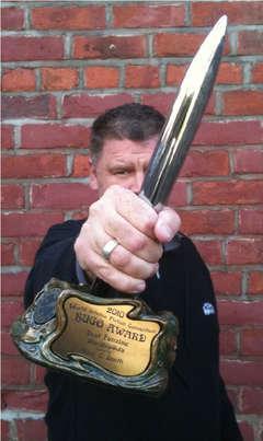 Tony C. Smith and his 2010 Hugo for StarShipSofa