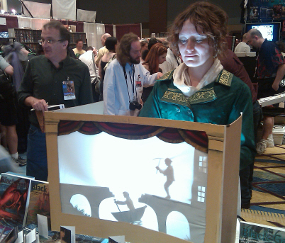 Mary Robinette Kowal does her puppeteer magic in the booth, as James Enge fends off fans
