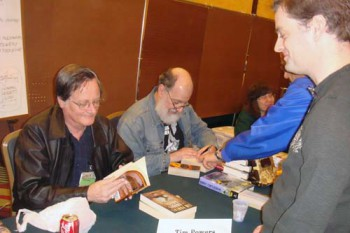 Annoying fan bug Tim Powers for his signature. Harry Turtledove sitting to Mr. Powers's left.