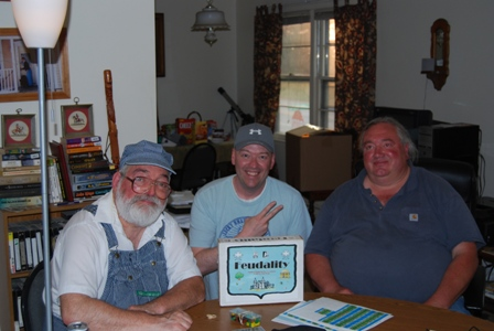 Tom Wham, me, and Ernie Gygax at a gaming table... PEACE OUT!