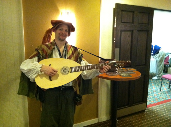 Dan the Bard entertains gamers in the halls with funny and original songs