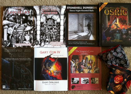 Some of the treasures I brought home from Gary Con IV. Check out those beautiful dice bags. Click for bigger version.