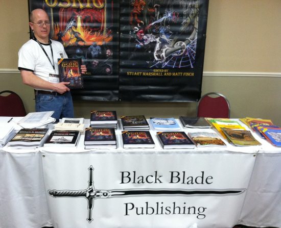 Jon Hershberger of Black Blade sells me a copy of OSRIC