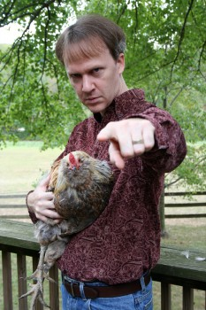 Howard Andrew Jones with his Review Rooster.