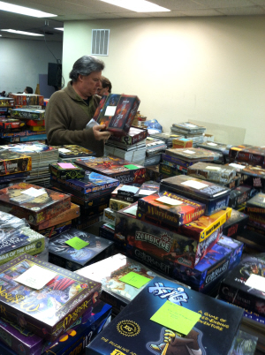 Just one of the mountains of games waiting to go to auction. Click for bigger version.
