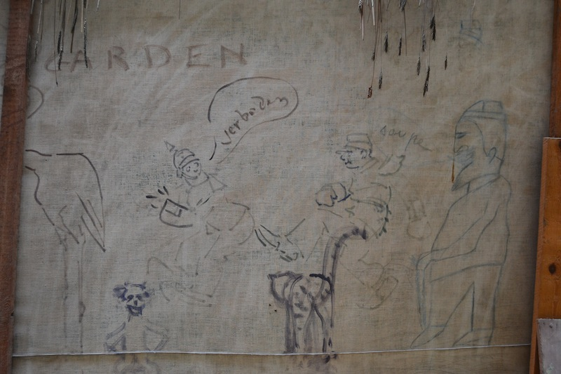 On the back wall, the painters doodled some more humorous pictures, poking fun at the Germans and the looming war.