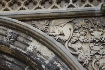 Medieval dragon guarding the gate to Norwich Cathedral.