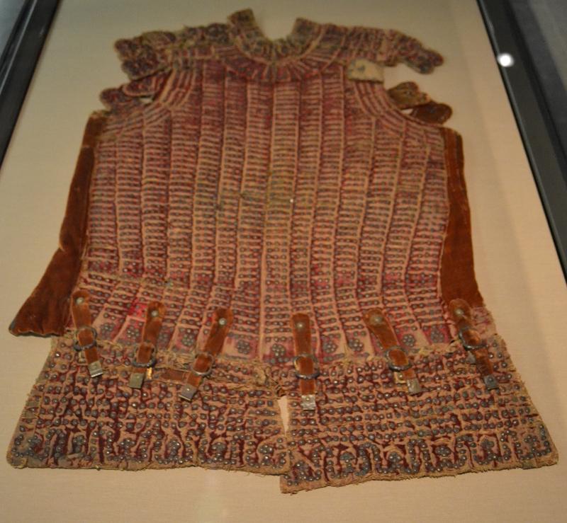 Studded cloth jerkin.
