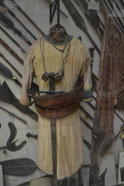 A Mahdist robe. Note the homemade ammunition belt and amulets worn around the neck that contain verses from the Koran.