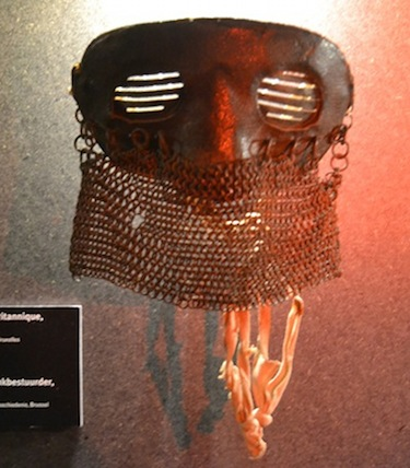 "Mask worn by a member of a British tank crew to protect himself from ""splash"", metal fragments coming off the inside surface of the tank when it got hit by bullets."