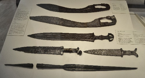 "Celtiberian swords and daggers from the 5th-3rd centuries BC. The curved weapon is a ""falcata"" common in southeastern Iberia."