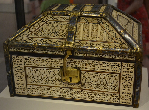 Casket from the Cathedral of Palencia. The intricate ivory work shows whorled leaves and palmettes, birds, animals, and hunting scenes. An Arabic inscription in Kufic-style calligraphy says it was made in 441 after Hijra (1049-1050 AD) in a workshop in Cuenca, Spain, by 'Abd al-Rahman ben Zayyan for the prince of Toledo.