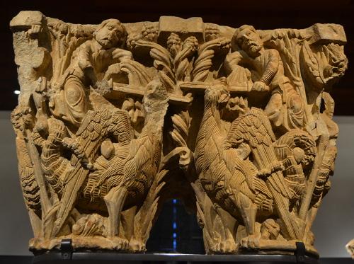Undated double column capital showing human figures and basilisks.