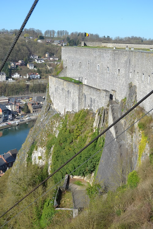 This shot shows the commanding position of the citadel of Dinant. The cables are for a cable car that visitors can ride up from town.