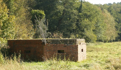 Many pillboxes were concrete faced with brick, as can be seen with this example near Waverley Abbey, Farnham, England. Photo courtesy Steve Parker via flickr.