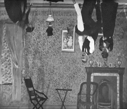Dancing on the ceiling in Upside Down, or The Human Flies (1899).
