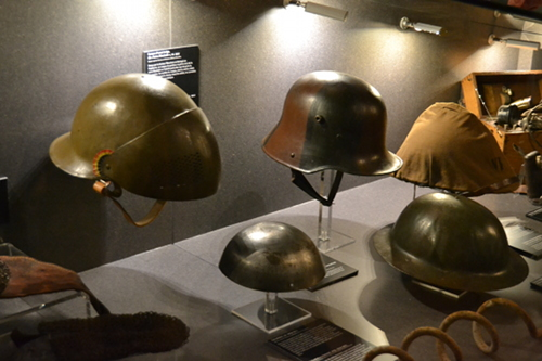 Various models of steel helmets. The little cap in the center is a French model, privately bought by a cautious soldier. Photo copyright Sean McLachlan.