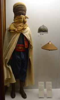 Above is a uniform of a French Spahi, a colonial soldier from northwest Africa from 1914. To the right is a French issue Adrian helmet and a hat distributed to troops from Indochina. Image copyright Sean McLachlan.