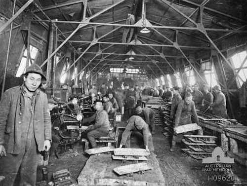 Members of the Chinese Labour Corps riveting metal plates for tanks.