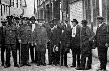 Black recruits from Cardiff, Wales, pose with recruiting officers for the British army.