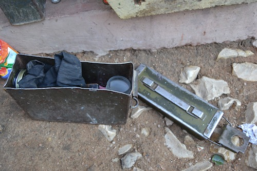 This battered old munitions box makes a handy place to store shoe shine and rags.
