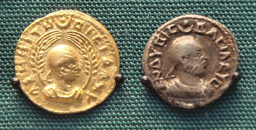 """Coins of King Endybis (ruled 227–35 AD). The left one reads in Greek """"AΧWMITW BACIΛEYC"""", """"King of Aksum"""". The right one reads in Greek: ΕΝΔΥΒΙC ΒΑCΙΛΕΥC, """"King Endybis"""". Photo courtesy Wikimedia Commons."""
