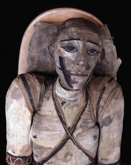 An unknown man of high status, c. 1st-3rd centuries AD, mummified in distinctive manner, with arms, legs, fingers and toes separately wrapped, facial features painted on the wrappings, natural hair left uncovered, small fragments of gold leaf preserved on the external surface.