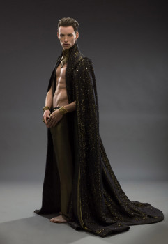Spooky sparkly cape, check. Gratuitous shirtlessness, check. Chiseled cheekbones, check.