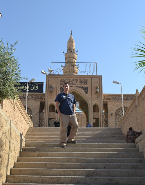 The author in front of the mosque of the Prophet Younis, or Jonah, in Mosul. ISIS militants blew it up in July 2014. Revered by Muslims as the burial place of Jonah, it was destroyed because ISIS believes shrines to be un-Islamic.