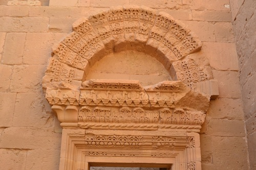 A typical Hatran archway. Note the camels and rosettes.