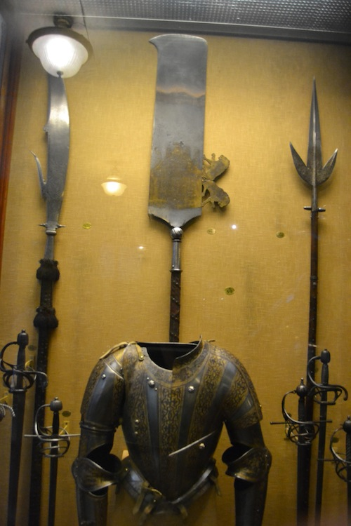 A trio of polearms. I can't imagine the one in the middle being any use in an actual fight, unless you were going to spank your opponent.