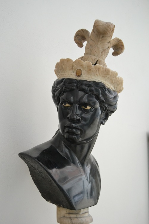 A bust of an African man with a headdress symbolizing the Americas, Italian, 18th century. COnsidering how Africans got to the Americas in the 18th cnetury, one can understand the angry expression. I wonder if this was a statement on the part of the sculptor?