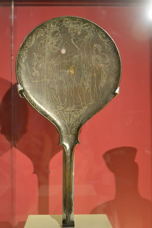 The regional archaeology museum has an excellent collection of artifact,s including this bronze mirror from Ancient Greece showing Athena and Hercules. Photo copyright Almudena Alonso-Herrero.