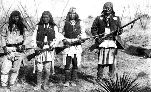 Geronimo (right) and some of his warriors at their final surrender in 1886.