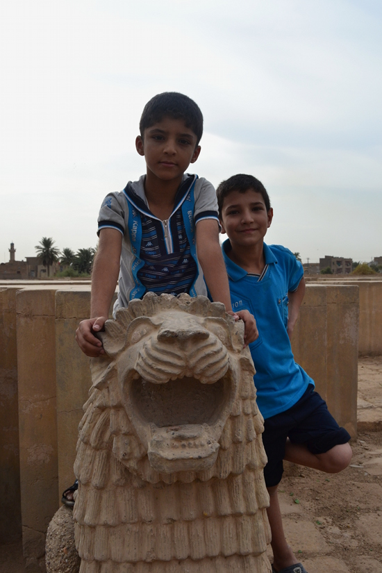 Kids goofing around at the Hermal archaeological site on the outskirts of Baghdad.