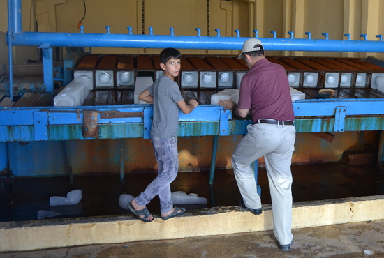 This boy helped run his dad's ice factory in a Christian community near Mosul.