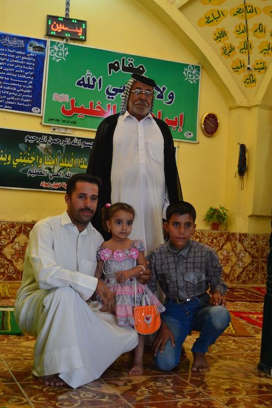 Three generations at a Shia shrine.