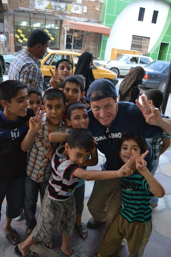 Yours truly with his little Nasiriyah buddies. Photo courtesy Rob Hammond.