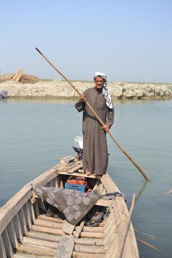 Marsh Arab boatman in southern Iraq.
