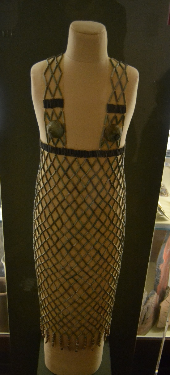 One of the prizes of the collection is this dancer's bead-net dress. Each of the 127 shells around the fringe are plugged with a small stone so that they rattled when the wearer moved..