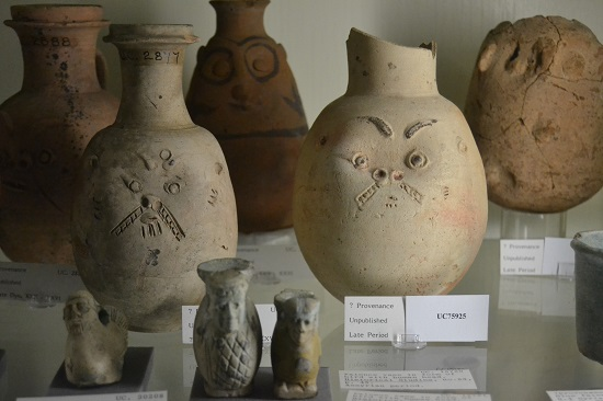 Vessels form the Late Period (c.712 - 332 BC) with faces that may depict the god Bes.