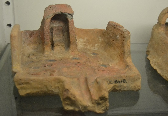 Clay offering table. Note that offerings are painted onto the surface.