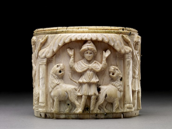 Ivory pyxis box depicting Daniel with arms raised in prayer flanked by two lions, Egypt or Syria, 5th or early 6th century AD © The Trustees of the British Museum