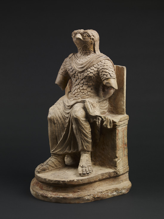 Seated figure of the ancient Egyptian god Horus, wearing Roman military costume, limestone, Egypt, 1st–2nd century AD © The Trustees of the British Museum