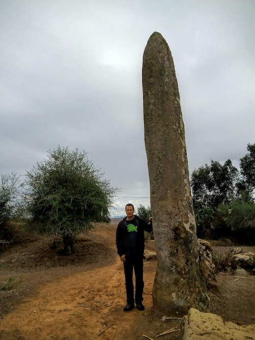 Yours truly next to the tallest standing stone. Photo courtesy Almudena Alonso-Herrero.