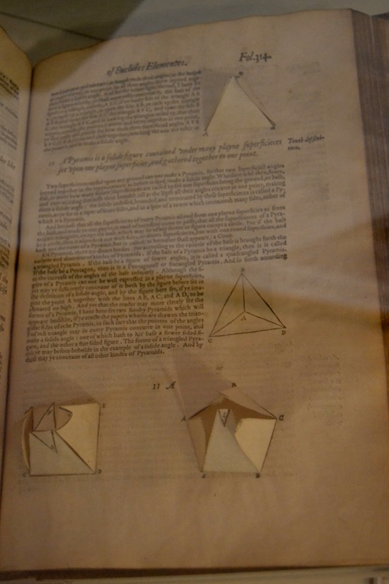 Dee's copy of Euclid's Elements of Geometry, in a 1570 edition that was the first English translation. Dee wrote the preface to this edition, which featured templates for making geometric cutouts that could be pasted into the pages.