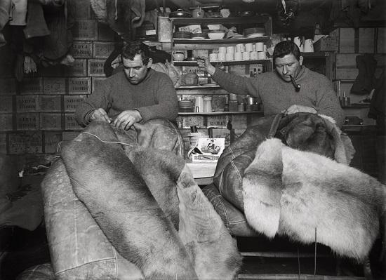 Herbert George Ponting - Petty officer Evans and Crean mending sleeping bags