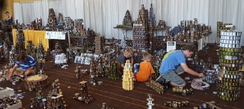 Cardhalla at GenCon is a fundraiser. Over the four day event, donated cards are used to build elaborate towers and other structures. On Sunday, convention goers hurl coins at the structures to topple them ... and the collected funds are donated,